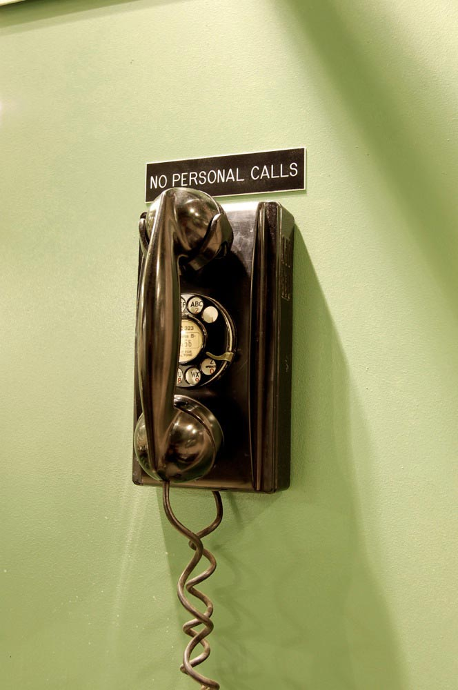 The phone on the wall is a 1951 Western Electric model 354 rotary-dial telephone, and it works perfectly.