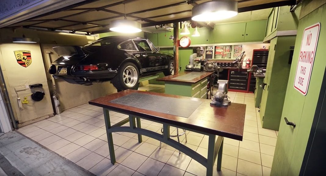 Porsche 911 standing on lift in garage