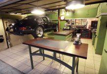 Porsche 911 standing on lift in garage