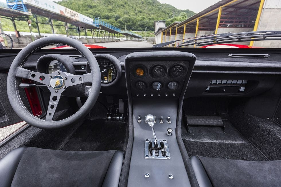 new 4-point safety belts, improved racing seats and a removable roll bar. All modifications were requested by the current owner to improve safety for race track driving.