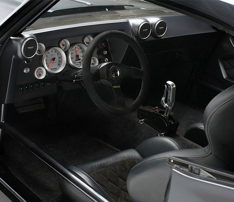 Marquez design dash, Sparco steering wheel, suede upholstery and analog auto meter gauges
