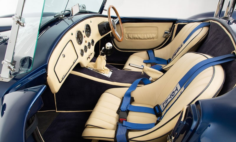 Dashboard and other elements in soft cream leather while the harnesses match
