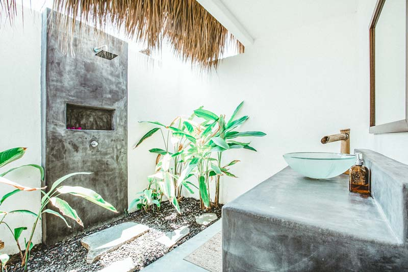 Open-air bathroom with a tropical shower