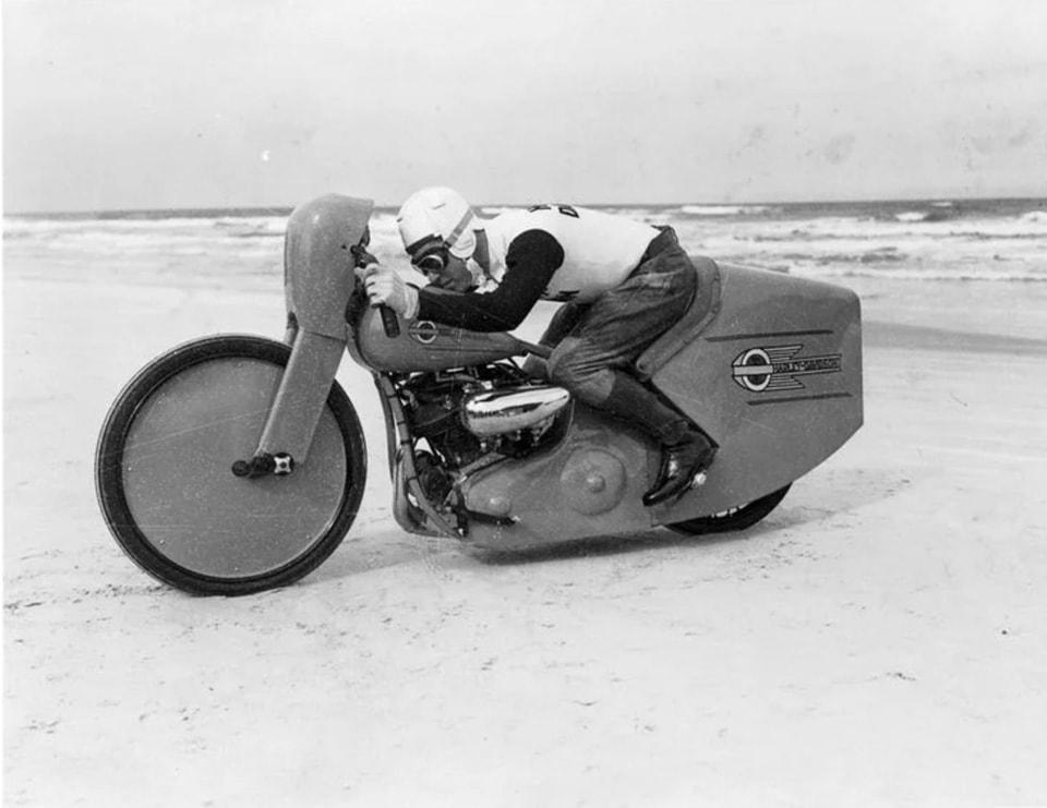 Publicity shot of Joe Petrali with streamliner bodywork