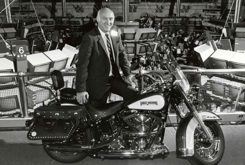 CEO Vaughn Beals with a Harley-Davidson