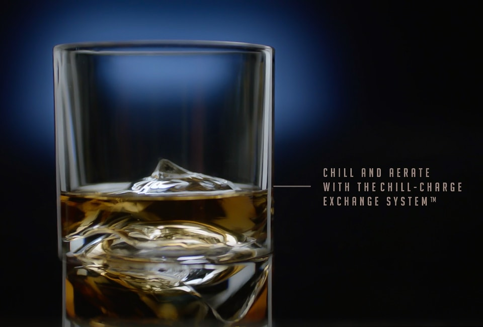 Self chilling whiskey glass